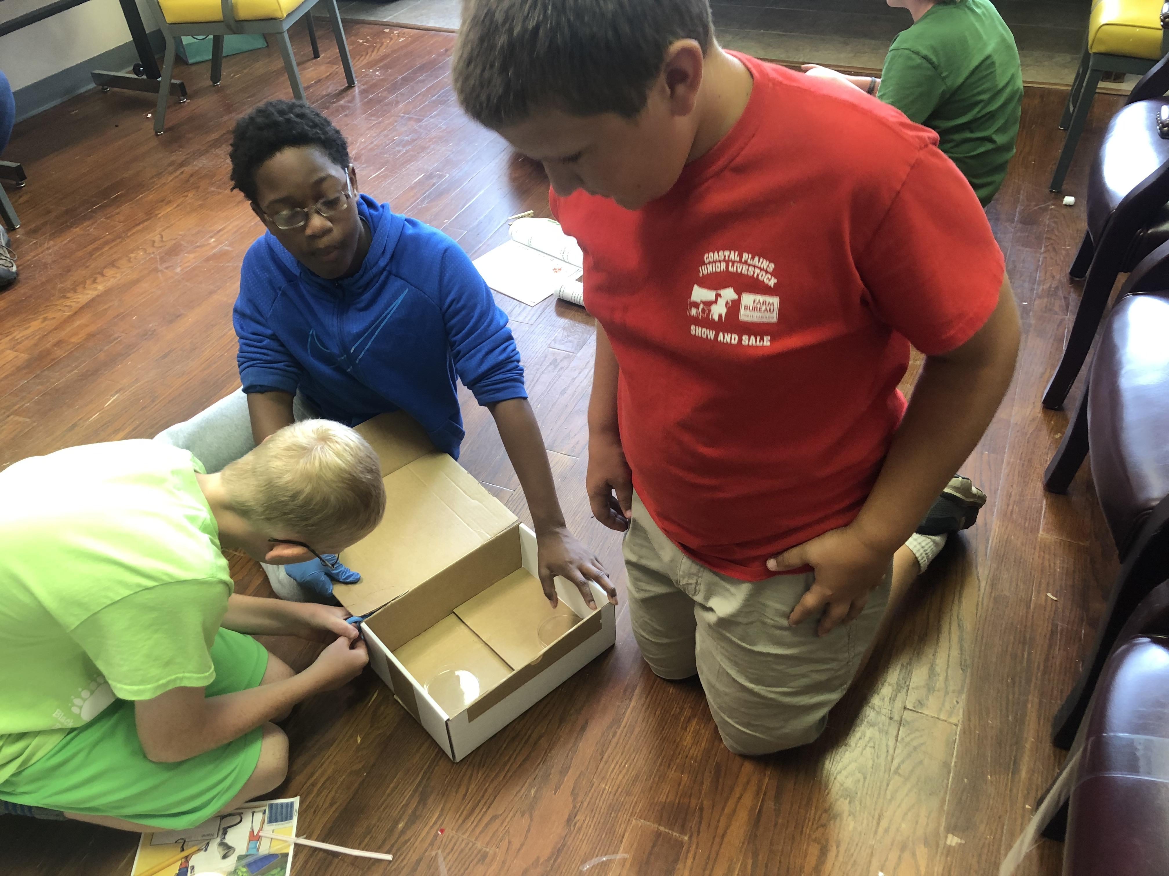 kids building quarantine box