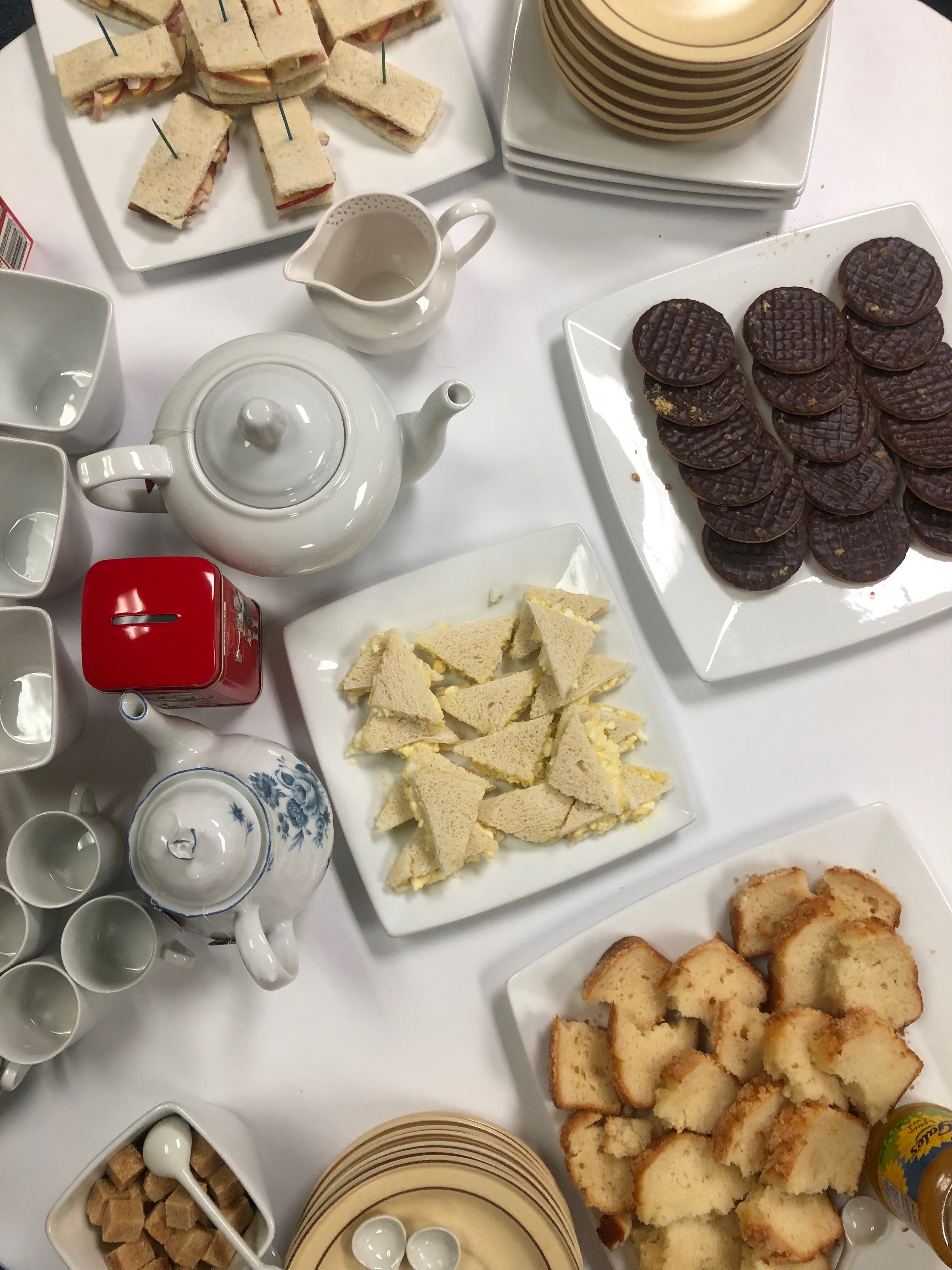 Afternoon Tea: Tea Cups, Tea Pots, Finger Sandwiches, Digestive Biscuits, Sponge Cake, and Lemon Curd