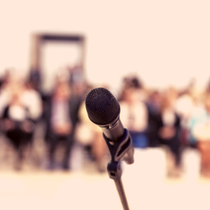 microphone with people faded in the background