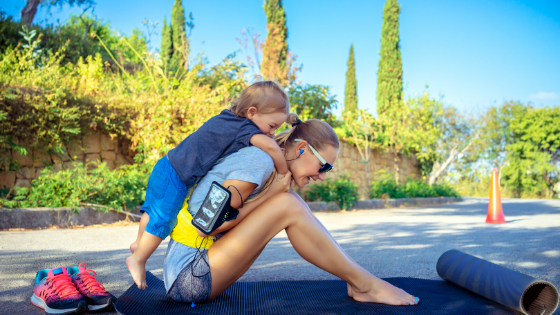Mom and child exercising outside