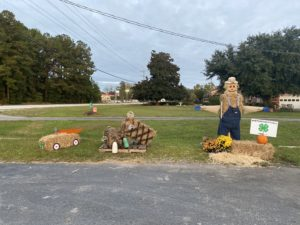 Hay bales made into a car, crab pots, and a scarecrow