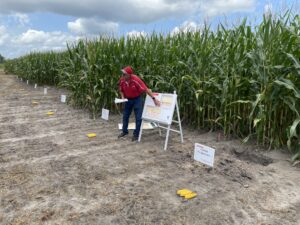 Researcher explaining on-farm research in the field